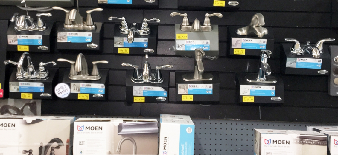 Kitchen & bath faucet display wall featuring Moen faucets